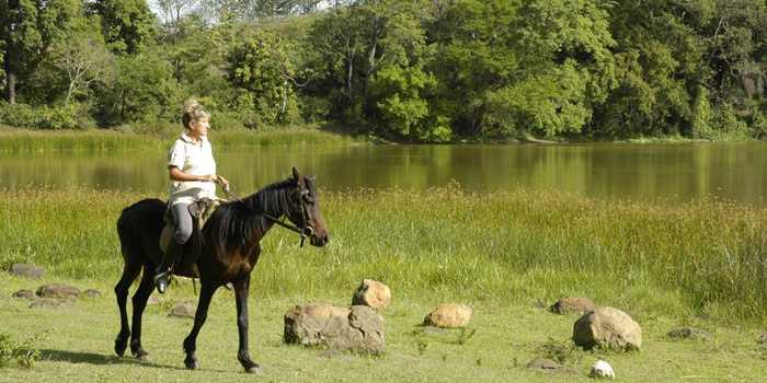 Horse riding by the lake