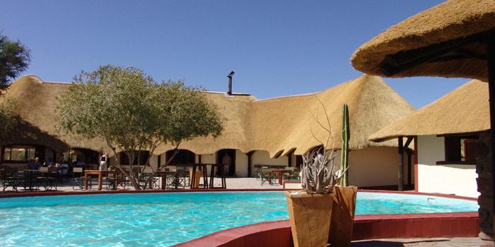 Namib desert lodge somak holidays for Red lodge swimming pool timetable