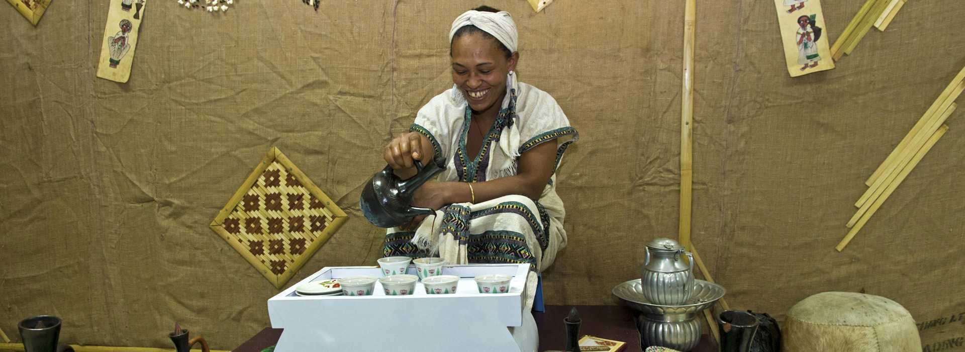 Woman Pours Coffee In Traditional Coffee Ceremony
