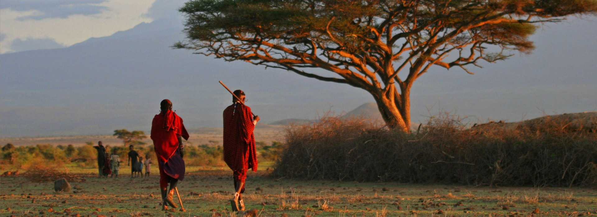 Masai Warriors At Sunset In The Mara