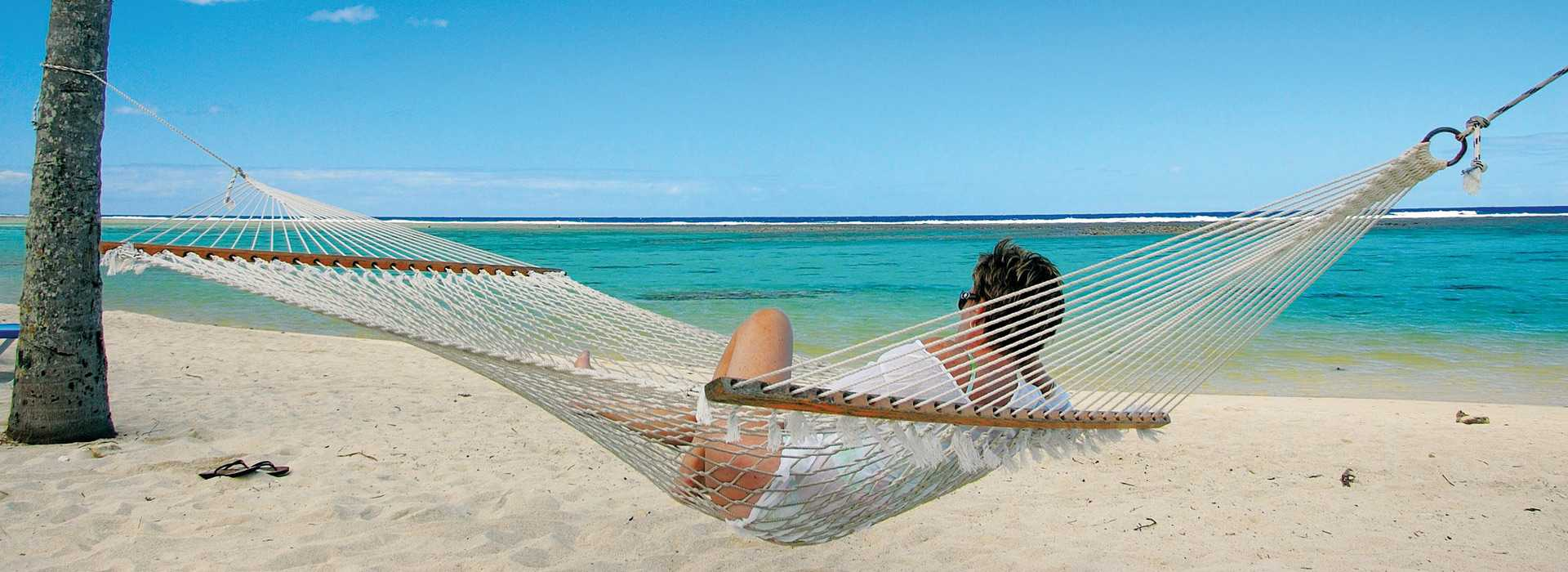 Woman Relaxing In Hammock On A Mozambique Beach
