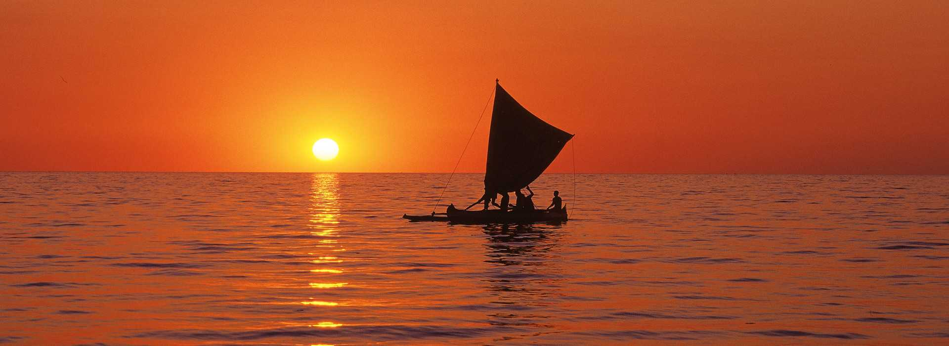 Fiery Sunset With Dhow On The Water