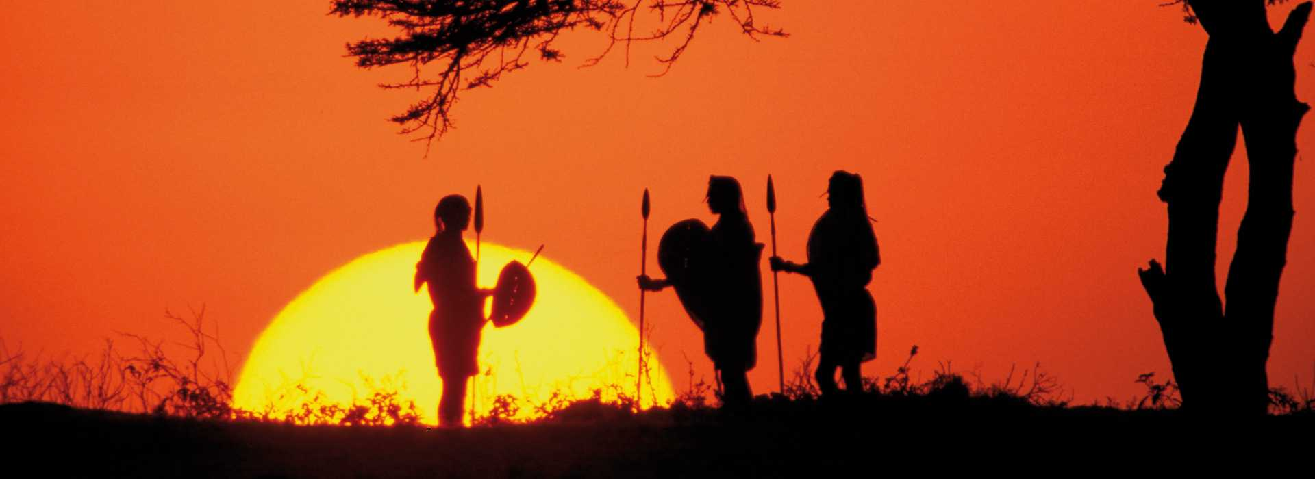 Warriors At Sunset In The Serengeti