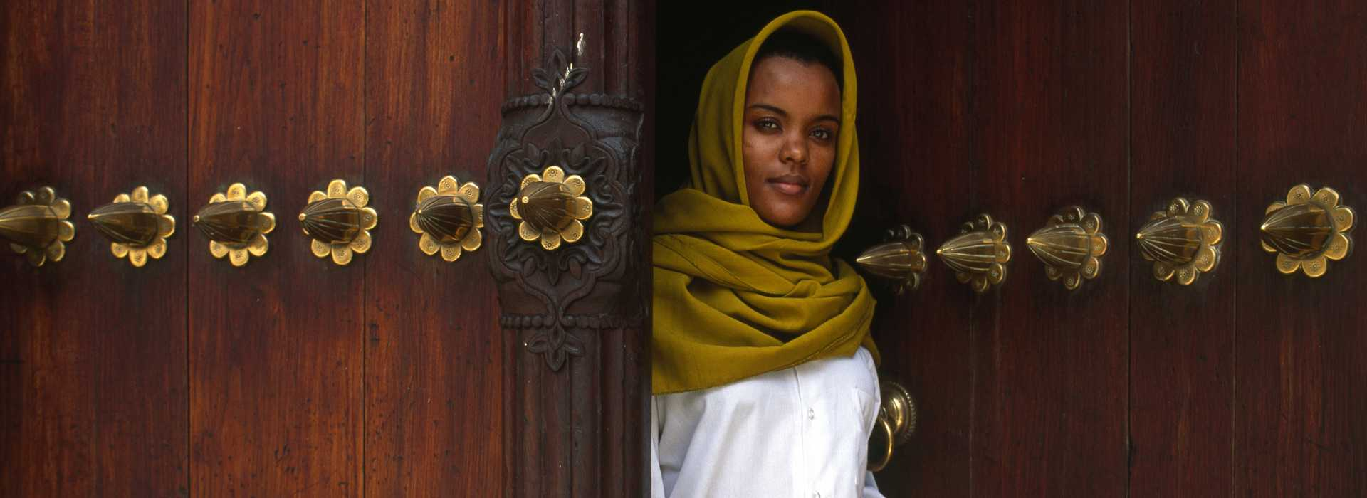Lady At Ornate Door In Stone Town, Zanzibar
