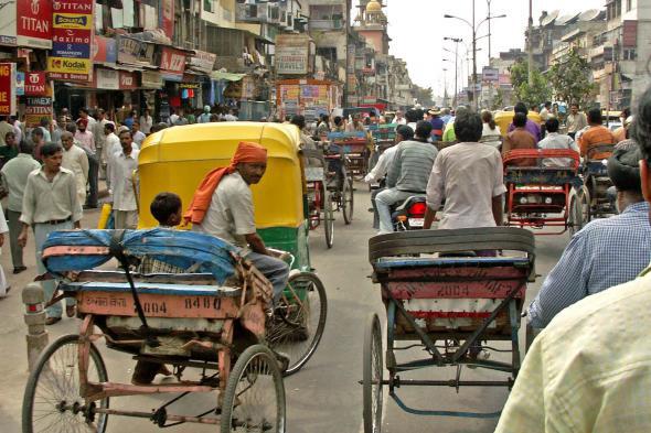 Tuk tuks in a street scene in Old Delhi, India
