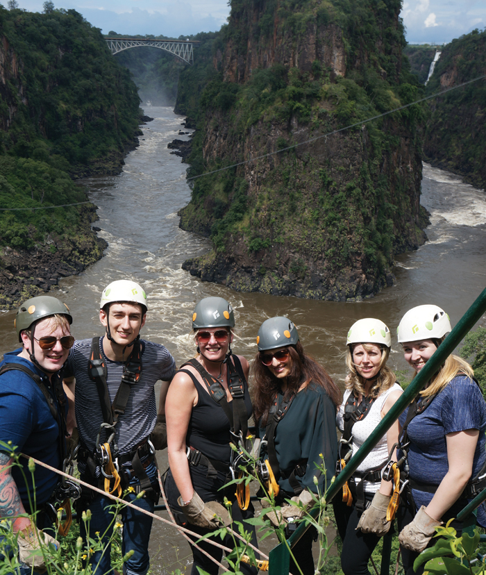 Group ready to go zip lining in Zimbabwe