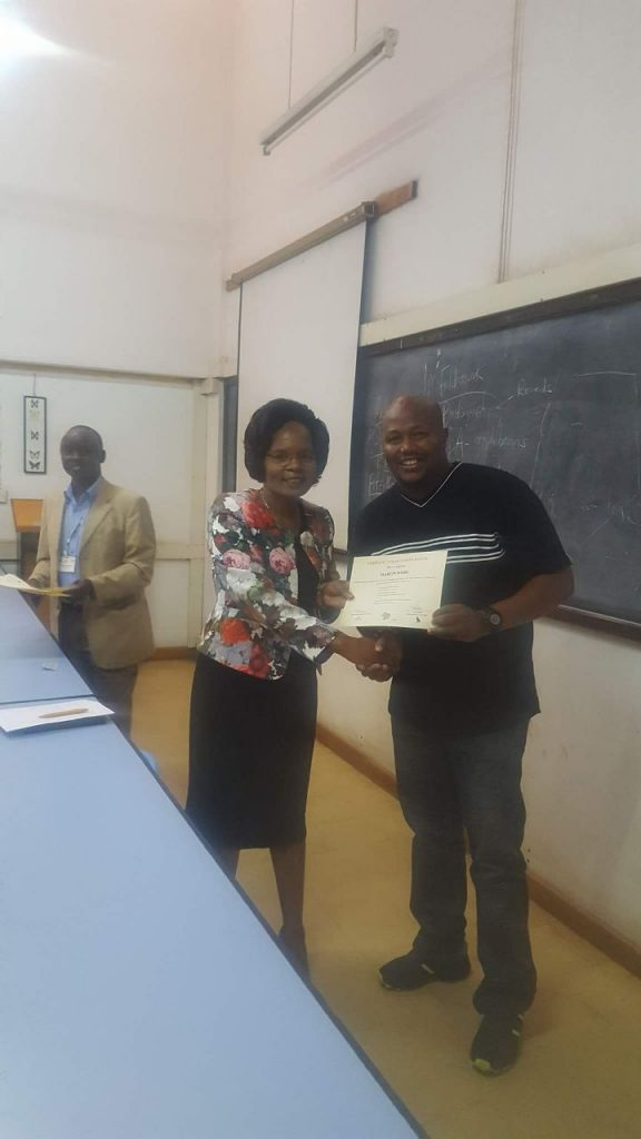 Martin receiving his certificate