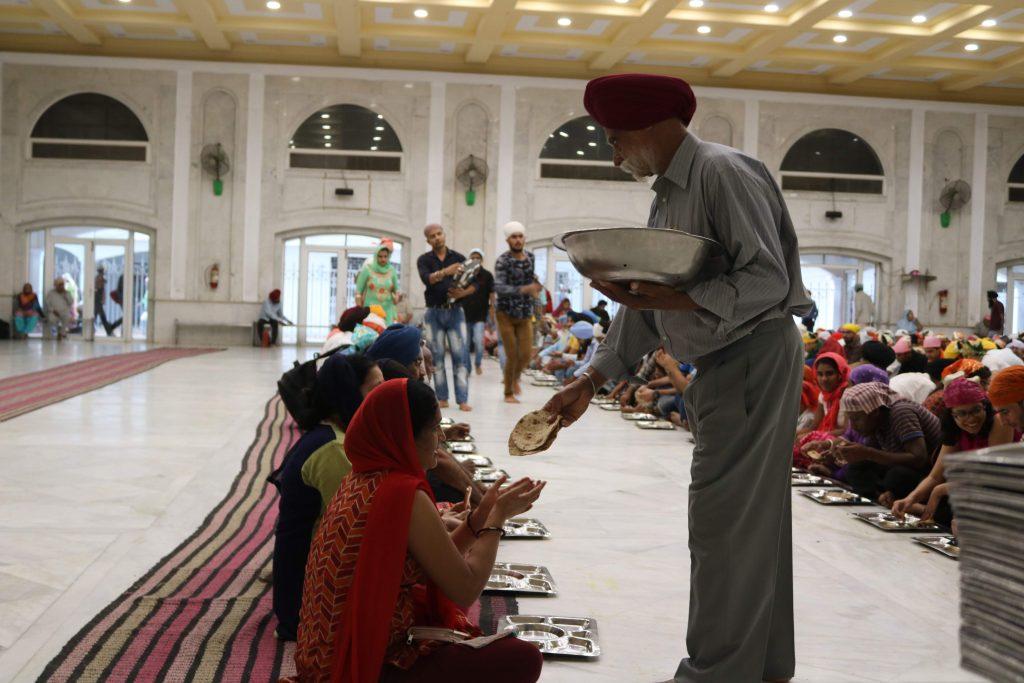 Feeding the visitors at Gurudwara Bangla Sahib