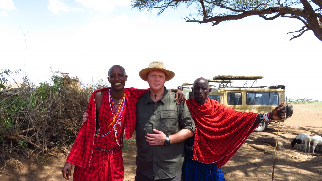 Guest with two Masai warriors