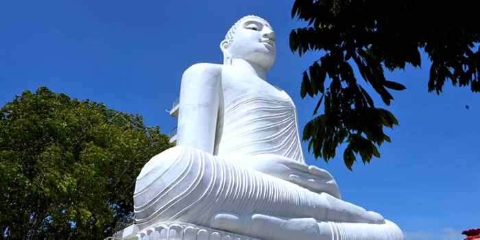 White Buddha statue in Sri Lanka